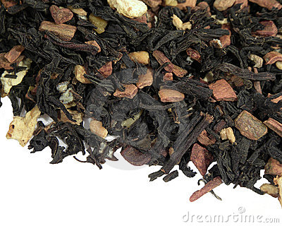 Black tea with dried fruit on a white background