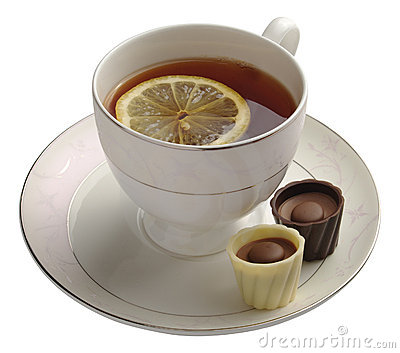 Black tea with lemon and chocolate candy