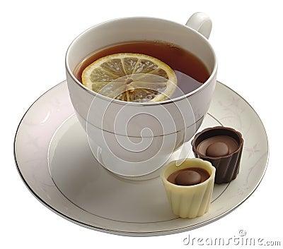 Black tea with lemon and chocolate candy