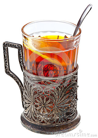 Black tea with lemon in retro glass