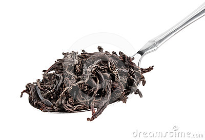 Black tea in spoon