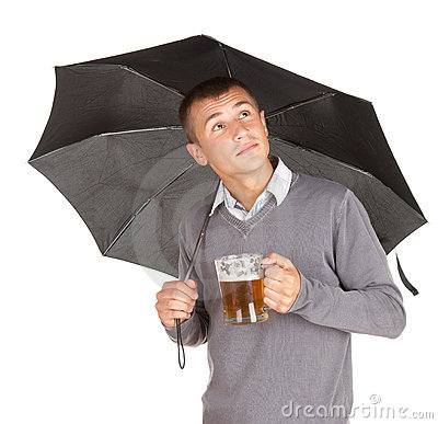 Black umbrella and young man with beer