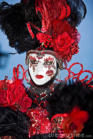 Black Venetian costume with red roses