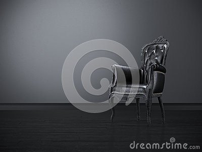 Black vintage chair in a dark room