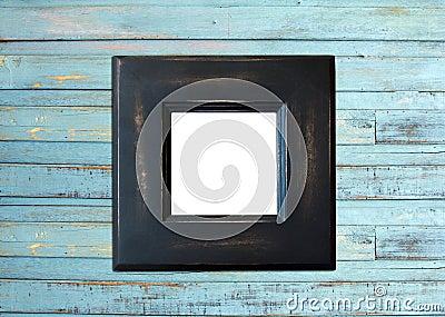 Black Vintage picture frame on blue wood