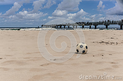 Black and white ball on the beach