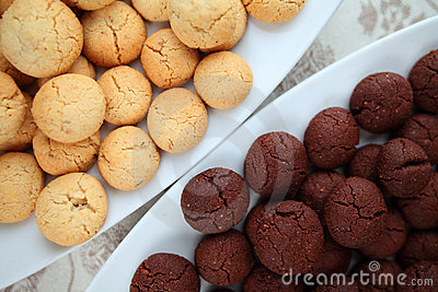 Black and white cookies on a damask tablecloth