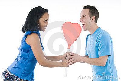 Black and white couple with hearth lollypop