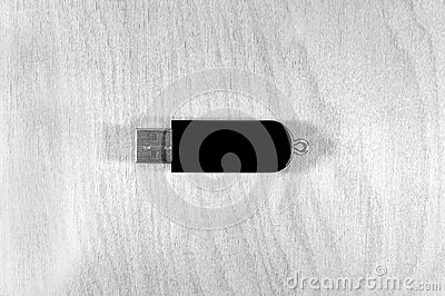 Black and white image of the flash drive on the texture of the t