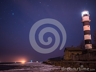 Black And White Lighthouse At Night In Baltic Sea Beach ...