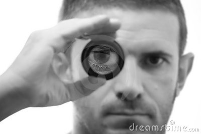 Black and white male face with magnifying lens