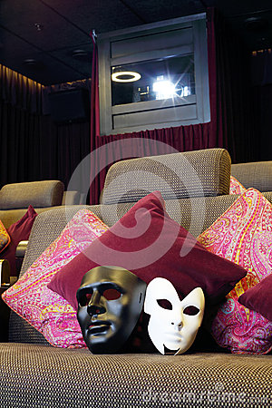 Black and white masks on couch with cushions and projector