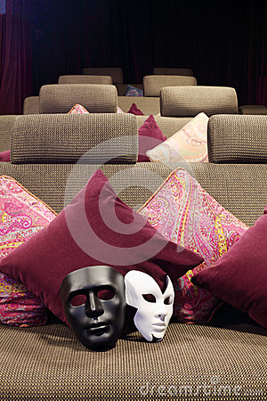 Black and white masks are on soft couch