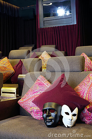Black and white masks are on soft couch with pillows