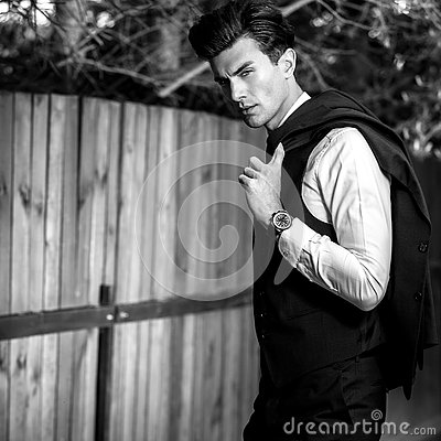 Free Black-white Outdoor Portrait Of Elegant Handsome Man In Classical Vest Near Wooden Fence Royalty Free Stock Photo - 80768725