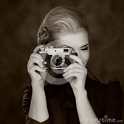Black and white picture of a woman with camera
