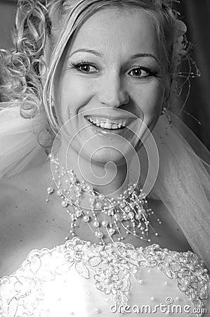 Black-and-white portrait of the happy bride