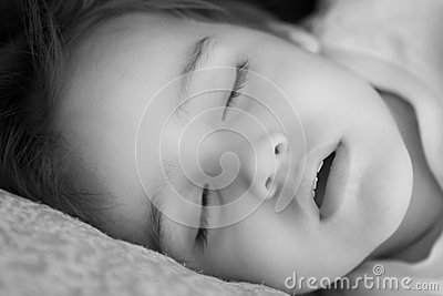 Black and white portrait of sleeping child
