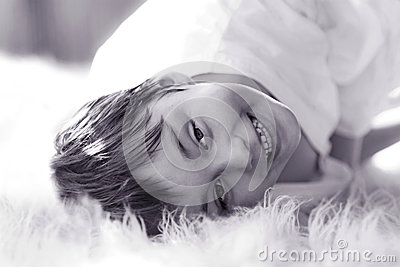 Black and white portrait of  smiling boy