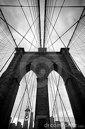 Black and white upward view of Brooklyn Bridge