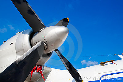 Black wings of an airplane motor in blue sky