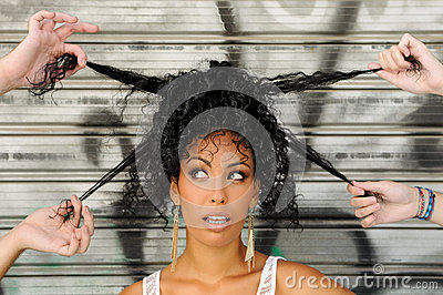 Black woman, afro hairstyle, in the city