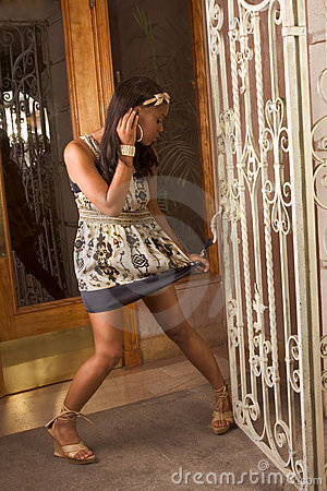 Free Black Woman Dress Stuck In Wrought Fence Royalty Free Stock Photography - 5956097