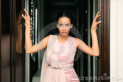 Black woman, model of fashion, with pink dress