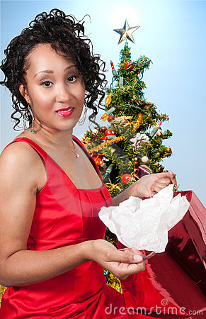 Black Woman Opening a Christmas present