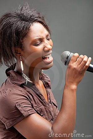 Free Black Woman Singing Into Microphone Stock Photo - 21139040