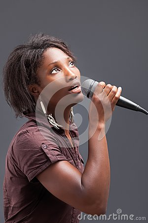 Free Black Woman Singing Into Microphone Stock Photo - 34770560