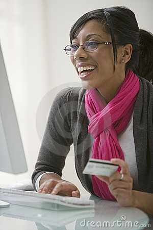 Black woman using credit card for e-commerce