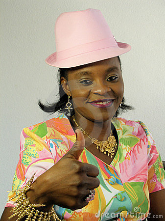 Black woman wearing a pink hat with thumb up 2