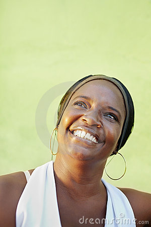 Black woman with white shirt smiling