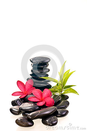 Black zen stones with red frangipani flowers