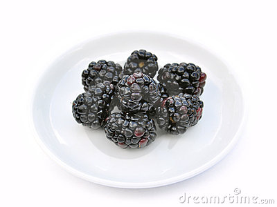 Blackberries on white dish