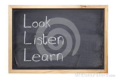 Blackboard with words Look Listen Learn