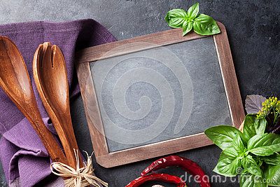 Blackboard for your text and garden herbs Stock Photo