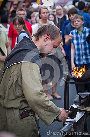 Free Blacksmith Forges Item On The Anvil. Stock Photography - 98347772