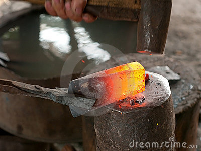 Blacksmith forging an ax
