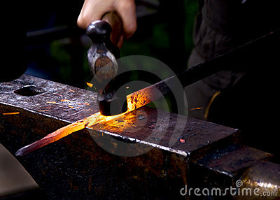 Blacksmith hammering hot metal