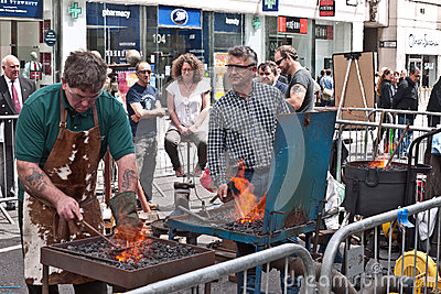 Blacksmiths demonstrate their work. Editorial Stock Image