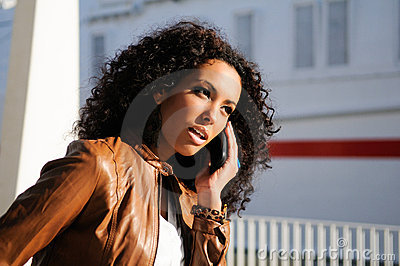 Blak woman talking on phone