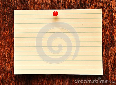Blank adhesive note against old wood background