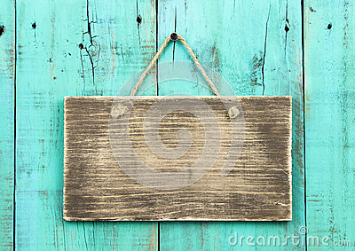 Blank Antique Wood Sign Hanging On Distressed Blue Green