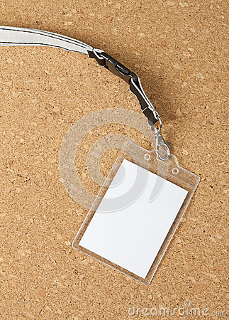 Blank badge with neckband on corkboard background. Stock Photo