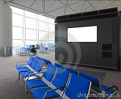 Blank billboard and blue chair in airport