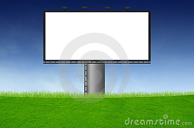 Blank billboard on green field