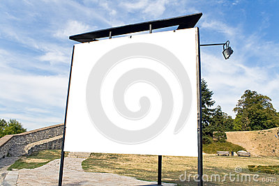 Blank billboard in a park