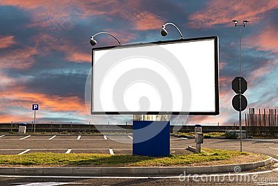 Blank billboard in a parking at sunset